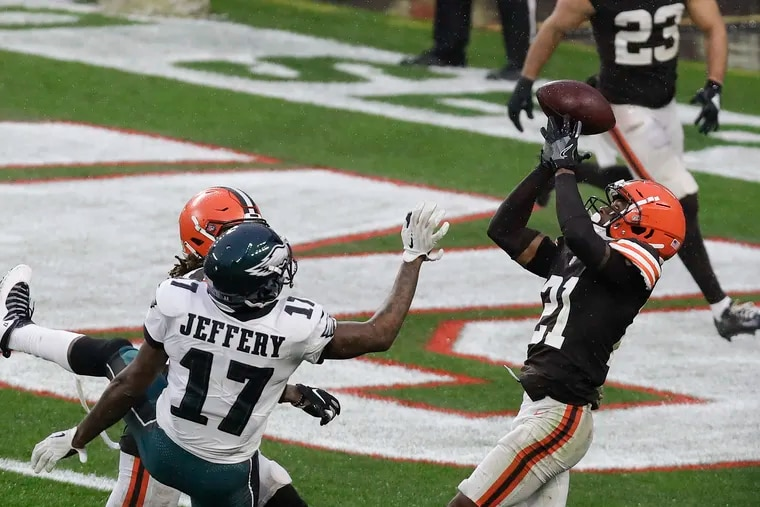 Browns cornerback Denzel Ward intercepts the football in front of Eagles wide receiver Alshon Jeffery late in the fourth quarter on Sunday.