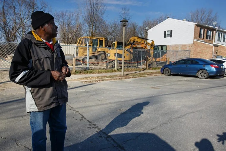 Earl Wilson, of the Eastwick Friends and Neighbors Coalition.  The EPA is removing contaminated soil from homes behind him.  The area is bordered by the Lower Darby Creek Superfund site, which is comprised of two landfills.