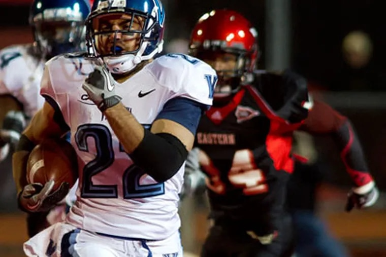 The Wildcats fell despite scoring on the game's first possession. (AP Photo/The Spokesman-Review, Colin Mulvany)