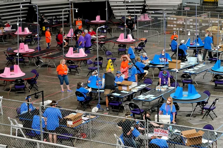 Maricopa County ballots cast in the 2020 general election are examined and recounted by contractors working for Florida-based company Cyber Ninjas at Veterans Memorial Coliseum in Phoenix in May.