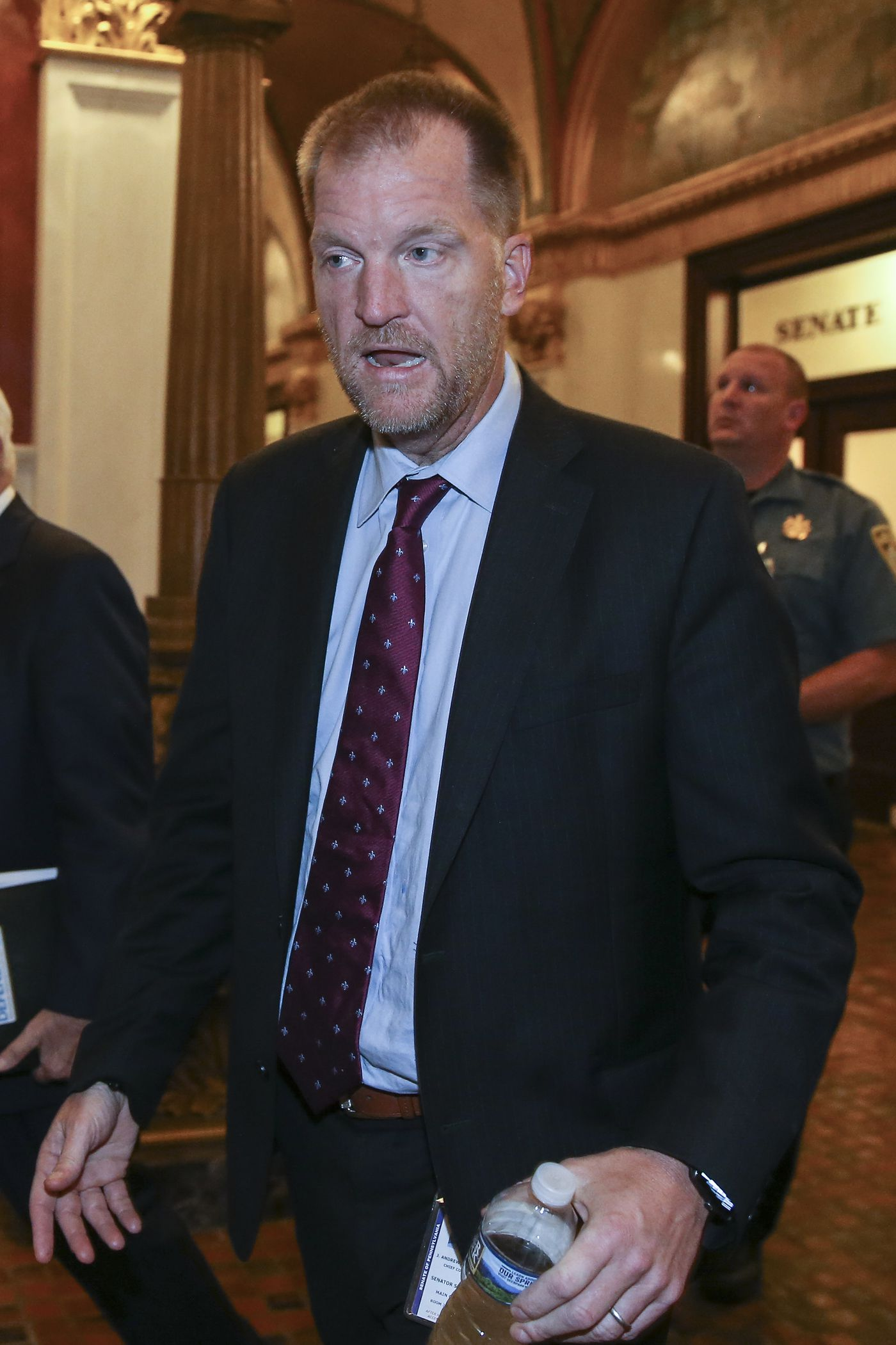 Drew Crompton, top lawyer for Pennsylvania Senate Republicans, walks through the Pa. Capitol after Senate efforts fail to pass a bill that would have allowed adult victims of child sexual abuse to sue their perpetrators but not institutions such as the Catholic Church.