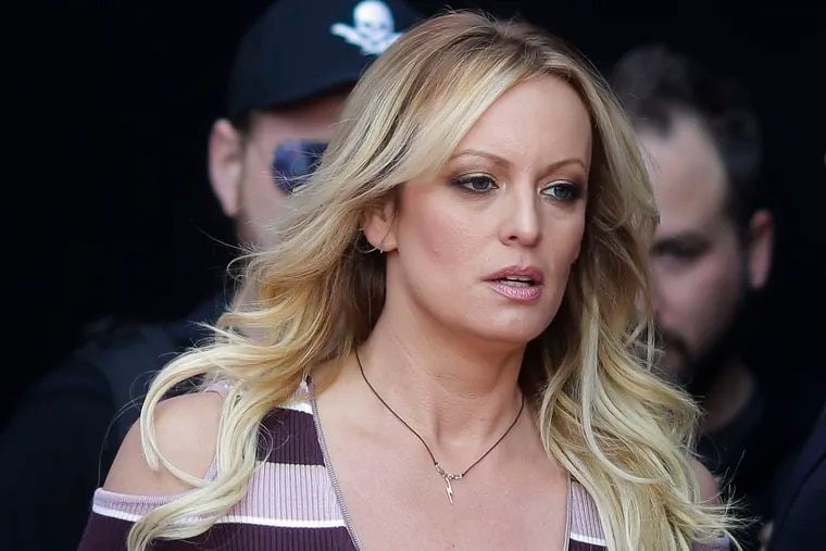 """FILE - In this Oct. 11, 2018, file photo, adult film actress Stormy Daniels arrives for the opening of the adult entertainment fair """"Venus"""" in Berlin. A federal judge has ordered porn star Stormy Daniels to pay Donald Trump nearly $293,000 for his attorneys' fees and another $1,000 in sanctions after her defamation suit against the president was dismissed. Judge S. James Otero made the order Tuesday, Dec. 11, 2018, in Los Angeles. Attorney Michael Avenatti, who represents Daniels, tweeted the order """"will never hold up on appeal."""" (AP Photo/Markus Schreiber, File)"""
