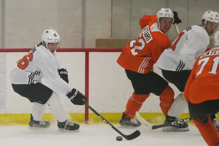Flyers prospect Bobby Brink (left) comes out with the puck during the team's developmental camp in Voorhees last year.
