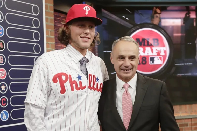 Phillies first-round pick Alec Bohm stands next to baseball commissioner Rob Manfred after being selected third overall Monday night in  Secaucus, N.J.