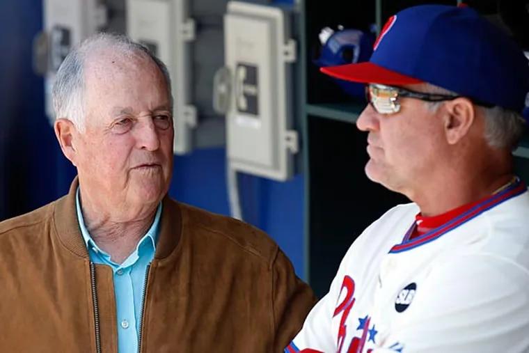 Phillies interim CEO Pat Gillick talks to manager Ryne Sandberg. (Yong Kim/Staff Photographer)
