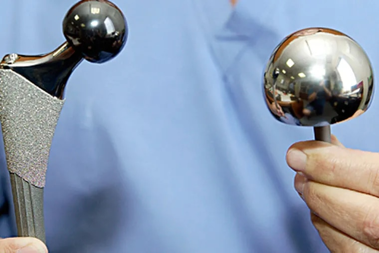 Artificial hip joints. The joints, made of specialty metals like titanium, survive 1,600- to 1,800-degree cremation just fine. (Tom Gannam / Associated Press)