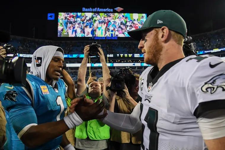 Panthers quarterback Cam Newton congratulates Carson Wentz after the Eagles' victory. Newton threw three interceptions. CLEM MURRAY / Staff Photographer