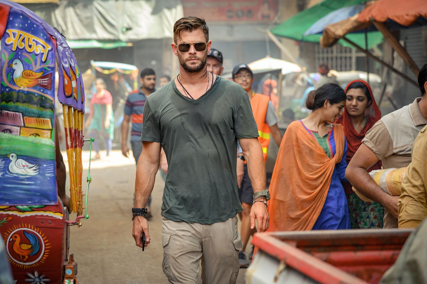 Chris Hemsworth's latest is 'Extraction' — emphasis on the 'action' — and these pecs need a rest