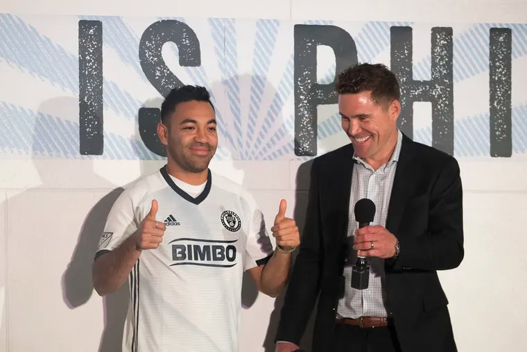 Chris Albright (right) was the Union's chief capologist, and helped bring international players including Marco Fabián (left) to the team.
