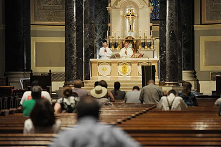 A noontime Mass at Cathedral Basilica of SS Peter and Paul. Why the donation lag? Officials aren't saying. (Sarah J. Glover/File photo)
