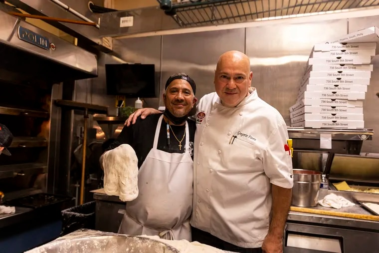 Gregorio Fierro (right), a chef and restaurant consultant, at Angelo's Pizzeria in South Philadelphia with owner Danny DiGiampietro. They met in 2013 and talk daily.