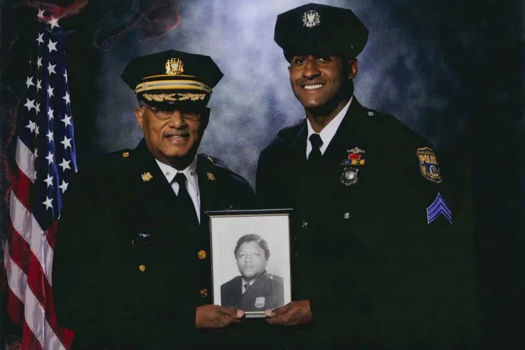 Three generations of Philadelphia policemen: Stephen T. Johnson Jr. with his father, who died of pancreatic cancer early last year, and holding a photo of his grandfather James Johnson. The son says the lawsuit isn't about the money, but about warning others.
