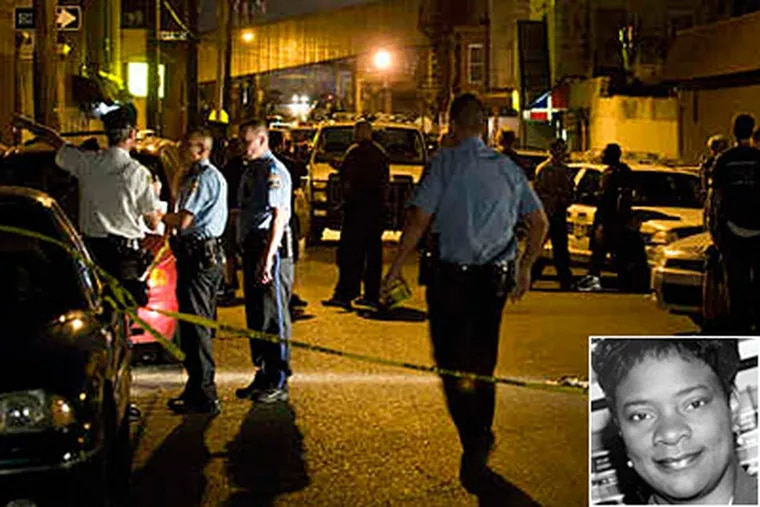 Patrol cars and officers converged in Kensington in July after a shootout. The District Attorney's Office is appealing rulings on 27 gun cases involving Judge Paula A. Patrick (inset). (File photo)