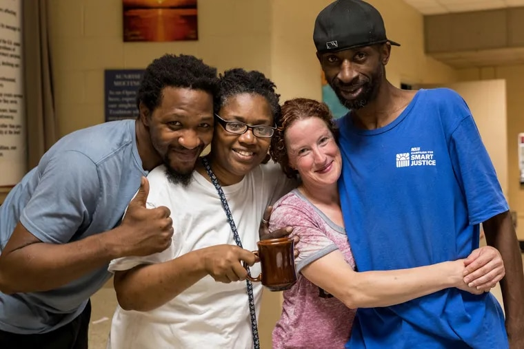 Margaux Murphy (center right) founded the Sunday Love Project, a non-profit that serves meals to those in need. Here, she poses with regulars (from left) Lawrence Miller, Lisa Johnson and Warren Lane during the organization's weekly Monday brunch service.