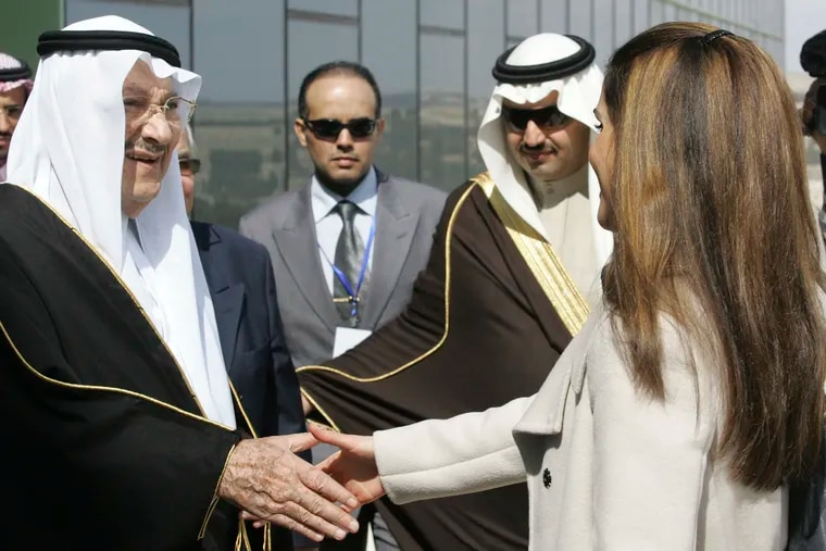 FILE - In this Feb. 24, 2010 file photo, Saudi Prince Talal bin Abdelaziz, left, receives Queen Rania of Jordan during the opening ceremony of the Arab Open University, Jordan branch, in Amman, Jordan. Abdulaziz, a senior member of the royal family who supported women's rights and once led a group of dissident princes, has died at the age of 87. Prince Talal was an older brother to King Salman and the father of businessman Prince Alwaleed bin Talal. The royal court said prayers for Prince Talal, who died on Saturday, will be held in Riyadh on Sunday, Dec. 23, 2018. (AP Photo/Nader Daoud, File)
