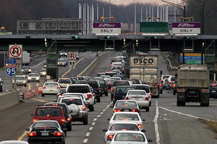 Northbound traffic backs up as drivers approach the toll plaza at Exit 1 of the New Jersey Turnpike, approaching the Delaware Memorial Bridge. (Elizabeth Robertson / Staff Photographer, file)