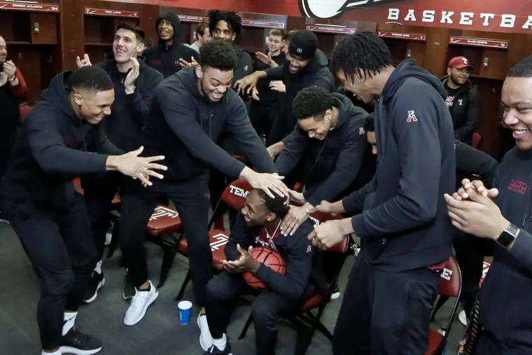 Shizz Alston (center) celebrates with his Temple teammates after they found out they earned a berth in the NCAA Tournament.