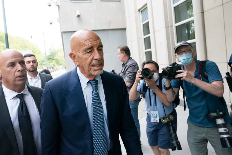 Tom Barrack, center, arrives at Brooklyn federal court on July 26 in New York. Barrack was among three men charged in New York federal court with trying to influence foreign policy while Donald Trump was running in 2016 and later while president. The chair of former President Donald Trump's 2017 inaugural committee allegedly conspired to influence U.S. policy to benefit the United Arab Emirates, even while he was seeking a position as an American diplomat.