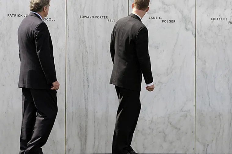 Gordon Felt, right, walks past the name of his brother Edward Felt, a passenger who was died on United Flight 93 as he views the Wall of Names during the dedication of phase 1 of the permanent Flight 93 National Memorial near the crash site of Flight 93 in Shanksville, Pa. Saturday Sept. 10, 2011.  (AP Photo/Amy Sancetta)
