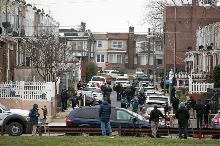 The crime scene on the 4700 block of Rorer street in the Feltonville section of Philadelphia, where police officers shot a man they said had a knife.