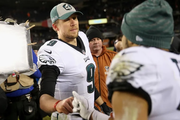 Nick Foles fist-bumps Golden Tate after he lead the Eagles to a first-round playoff win.