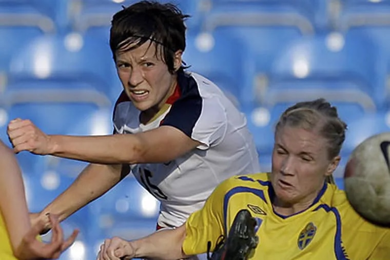 Megan Rapinoe contributed four goals and two assists for the U.S. national team in 2010. (Armando Franca/AP file photo)