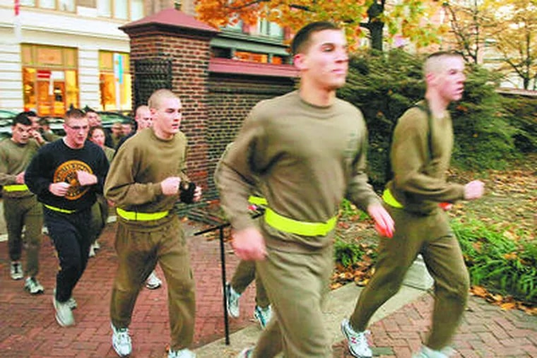 A group of ROTC cadets from the University of Pennsylvania and Villanova University run through the gate at the Arch Street Friends Meeting for a ceremony honoring Maj. Samuel Nicholas.