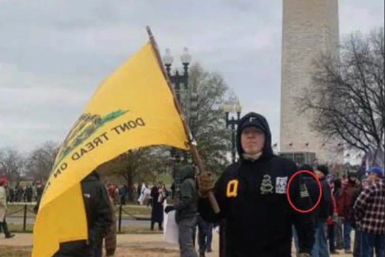 A photo FBI agents recovered from Kenneth Grayson's deactivated Facebook account shows him posing in front of the Washington Monument, shortly before he joined a pro-Trump mob in storming the U.S. Capitol on Jan. 6 in Washington.