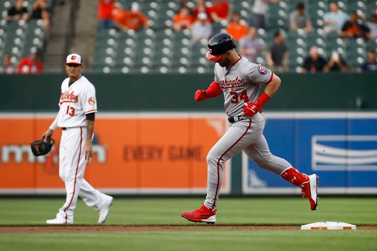 Over the past three weeks, the Phillies have met with both Manny Machado, left, and Bryce Harper.
