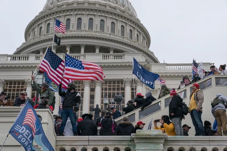 Rioters supporting then-President Donald Trump storm the Capitol in Washington on Jan. 6. Far from creating a moment of regret or reflection for many Republicans, last week's grim six-month anniversary showed how the GOP has doubled down on the lies and conspiracies that sparked the insurrection — including in Pennsylvania.