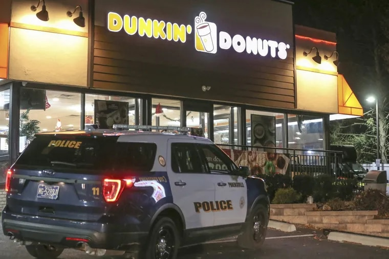 Phoenixville police investigate a shooting at a DunkinÕ Donuts where a ninth grader was shot and wounded Wednesday night, December 27, 2017.