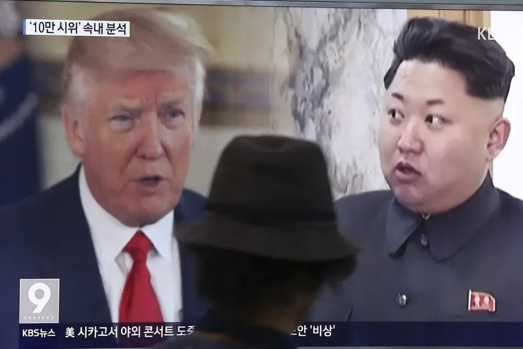 A man watches a television screen showing President Donald Trump and North Korean leader Kim Jong Un during a news program at the Seoul Train Station in Seoul, South Korea, Thursday, Aug. 10, 2017.  (AP Photo/Ahn Young-joon)