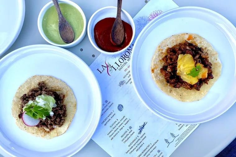 Short rib tacos (left) and tacos al pastor at La Llorona Cantina.