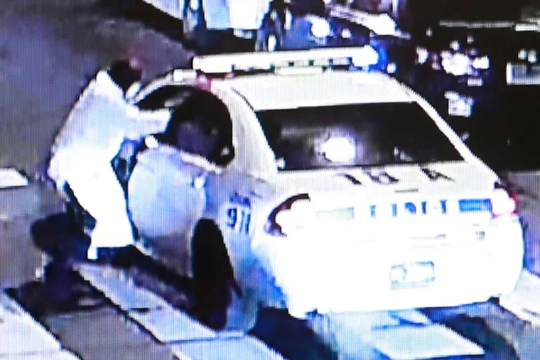 Video shows Edward Archer walking toward Officer Jesse Hartnett's police car at 60th and Spruce Streets while shooting. Hartnett was shot three times in an arm but managed to pursue and wound Archer.
