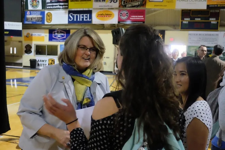 La Salle University President Colleen Hanycz happily greets juniors Marissa Beaver , , center, and Emily Paynter, right, on campus last year. Ed Hille / Staff Photographer