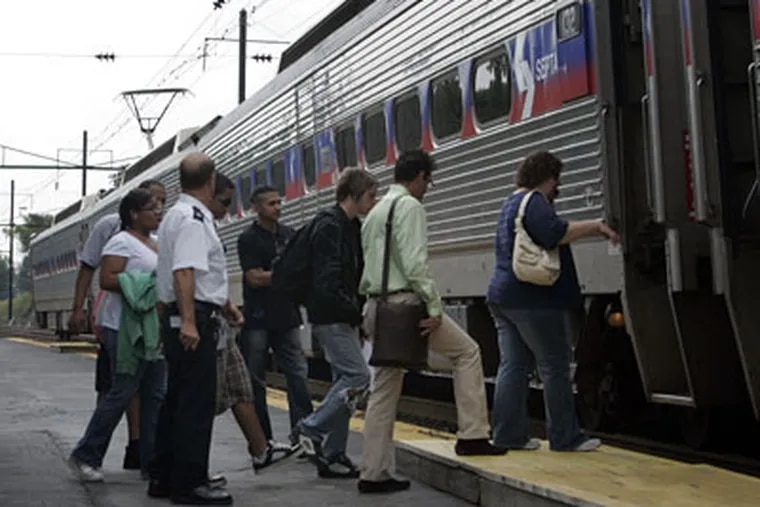 Afternoon commuters board the R5 Paoli/Thorndale train at the Downingtown SEPTA rail station on Wednesday afternoon. SEPTA plans to expand service. (Laurence Kesterson / Inquirer)