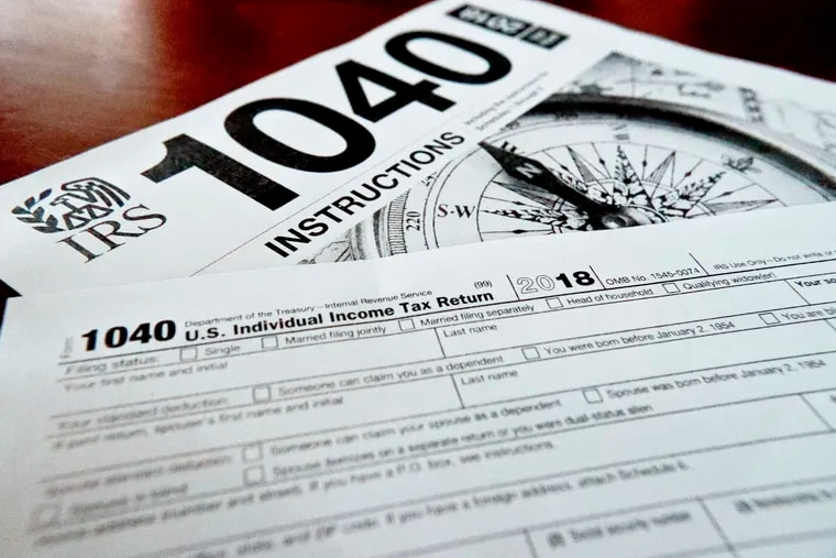 This Feb. 13, 2019, file photo shows multiple forms printed from the Internal Revenue Service web page that are used for 2018 U.S. federal tax returns in Zelienople, Pa. The tax overhaul changed how much employers withhold from paychecks. If you withhold too much, you are due a refund. If you withhold too little, you owe. While the government urged people to review their withholdings to make sure they were up to date, few did. As a result, some people got more money in their checks during the year but were surprised at tax time. (AP Photo/Keith Srakocic, File)