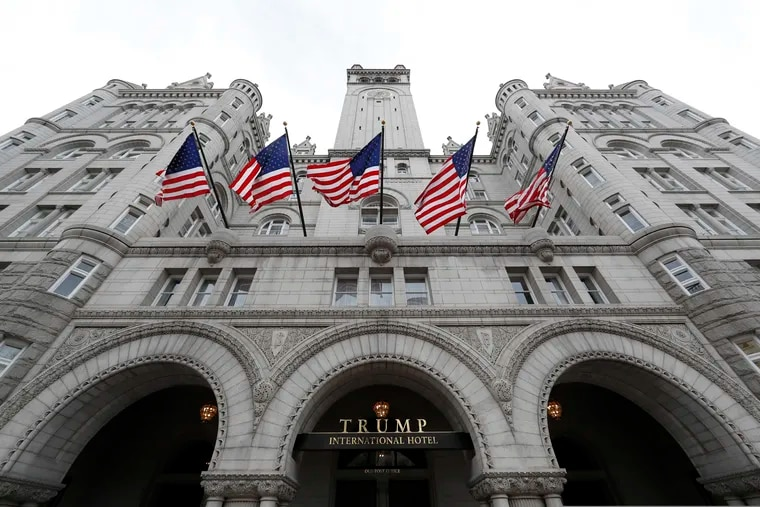 FILE - This Dec. 21, 2016, file photo shows the Trump International Hotel at 1100 Pennsylvania Avenue NW, in Washington. The Justice Department is challenging a Maryland federal judge's decision allowing a case accusing President Donald Trump of profiting off the presidency to go forward. It wants an appeals court to take the case instead. (AP Photo/Alex Brandon, File)