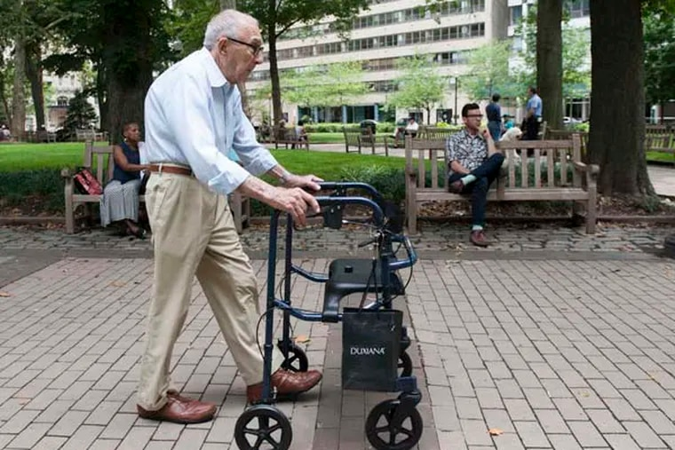 Bernard Evans takes a walk in Rittenhouse Square. Evans volunteers for Penn's Village, a group of senior citizens who live in Center City and choose to live at home.