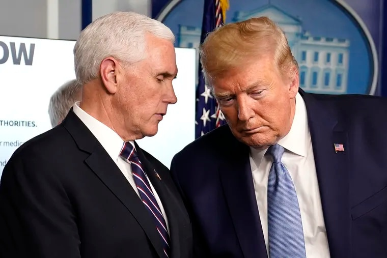 President Donald Trump listens to Vice President Mike Pence during a press briefing with the coronavirus task force, in the Brady press briefing room at the White House, on Monday, March 16, 2020, in Washington.