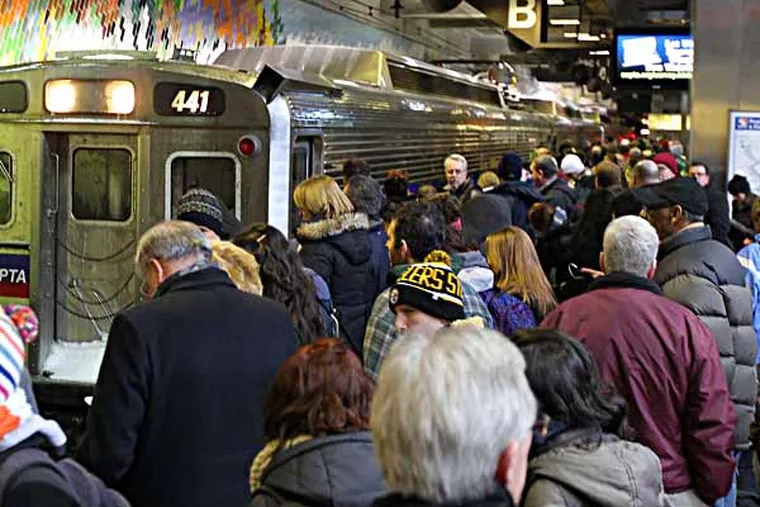 Commuters wait for trains at SEPTA's Market East station during the snow storm in Philadelphia, Pa. on Jan. 21, 2014. (David Maialetti / Staff Photographer)