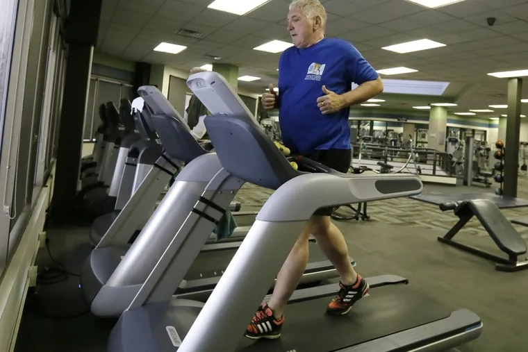 Unlike some heart attack patients, former Inquirer sports editor John Quinn went to cardiac rehab after surgery — a program that includes supervised exercise. He has since kept up the fitness habit, shown here at The Rec Center at Rowan University.