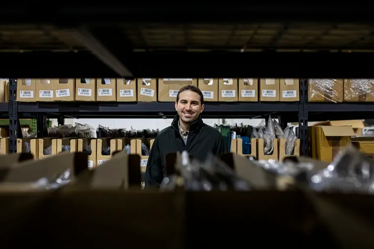 """Brian Antar, 32, CEO of Shipmate Fulfillment, inside the company's facility. """"We talk to people all over the world,"""" Antar said. """"Learning who they are, their story, where they're coming from, and see if we can help. Especially how the they are dealing with COVID."""""""