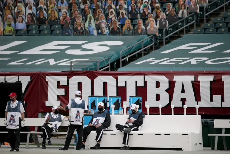 Officials sitting on the bench during a delay before the Temple-East Carolina 2020 football game at Lincoln Financial Field.