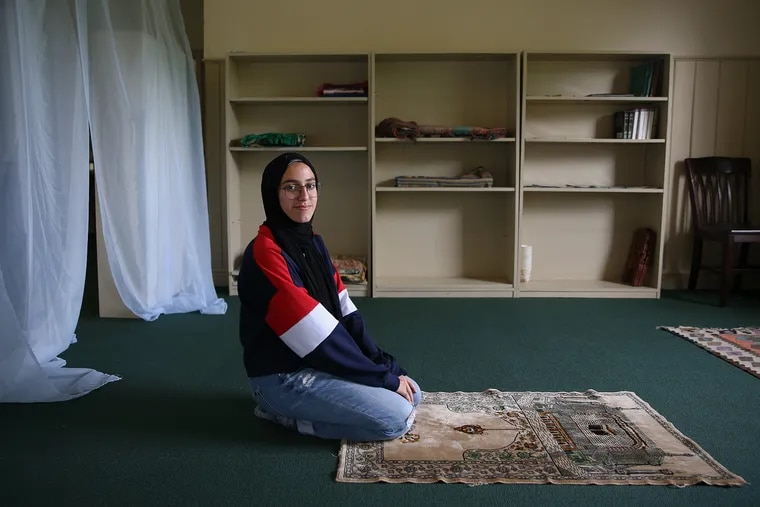 George School senior Saleema Walter, 17, of North Brunswick, N.J., kneels for a portrait in the new prayer space for Muslim students and faculty on the school's campus in Newtown, Pa.