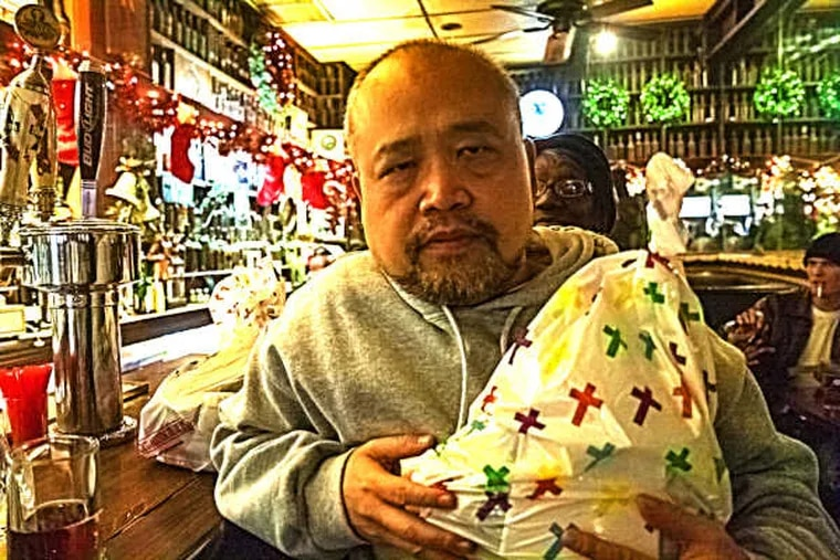 """Linh Dinh, author of """"Postcards from the End of America,"""" in Jack's Famous Bar on Christmas Eve."""