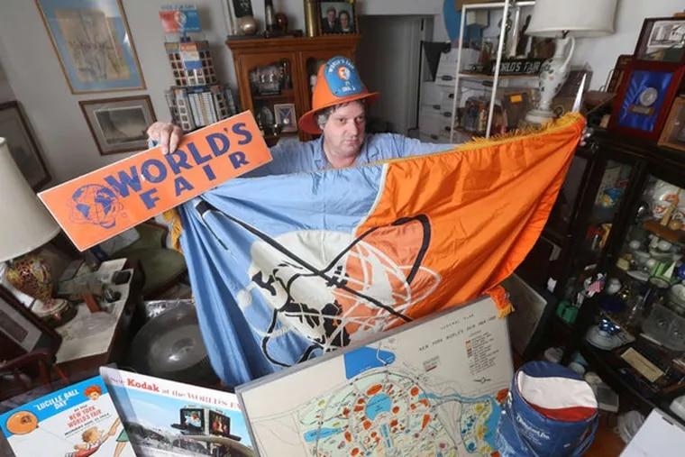 John Riccardelli shows off his huge collection of World's Fair items that are kept in his apartment in New Milford, N.J., Monday, April 14, 2014. Here, he wears a World's Fair fireman's helmet, and holds up a World's Fair flag that hung behind the desk of Robert Moses, as well as posters and maps of the Fair. (Chris Pedota/The Record/MCT)