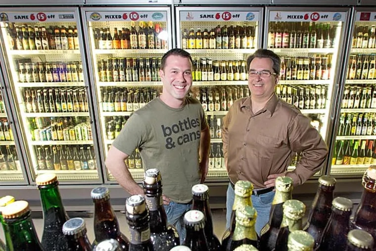 """Brad Helder (left) and Mike Kellett at their new Bottle Bar East. One entrepreneur says the area is """"going back to its roots, when Frankford Avenue was 'the' avenue for shopping."""" (David M Warren / Staff Photographer)"""
