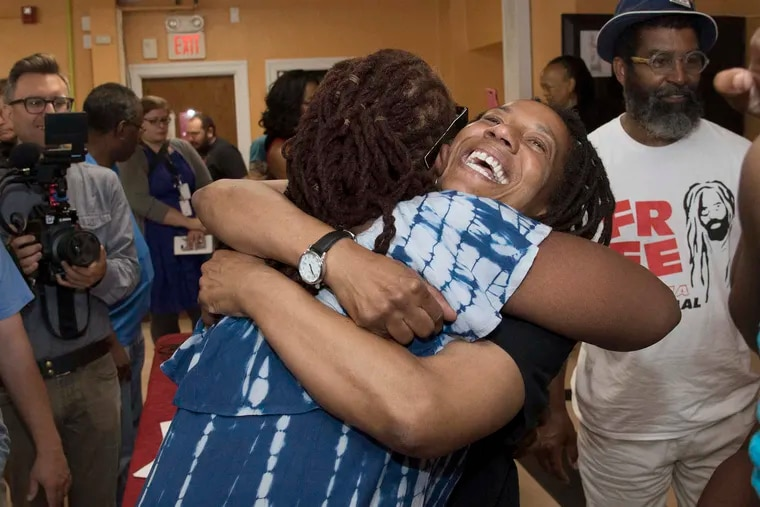 Debbie Africa, right, with long time friend, Angie Crawford, minutes after her first public appearance at the Faith Immanuel Lutheran Church, in East Lansdowne, Pennsylvania on Tuesday morning June 19, 2018. Debbie is first MOVE member granted parole after 38 years in prison.