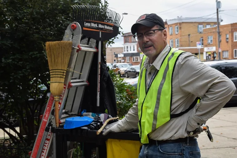 Eric Kramer is a season maintenance worker who cleans up Campbell Square Park. He and his pals wondered why the city took their trashcans.